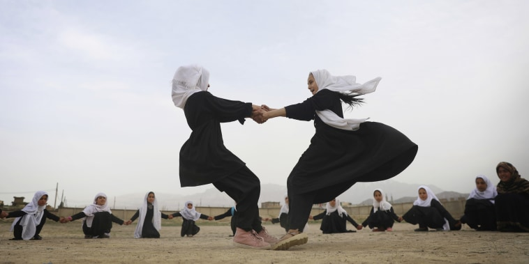 Afghan students play in a primary school in Kabul, Saturday, March 27, 2021