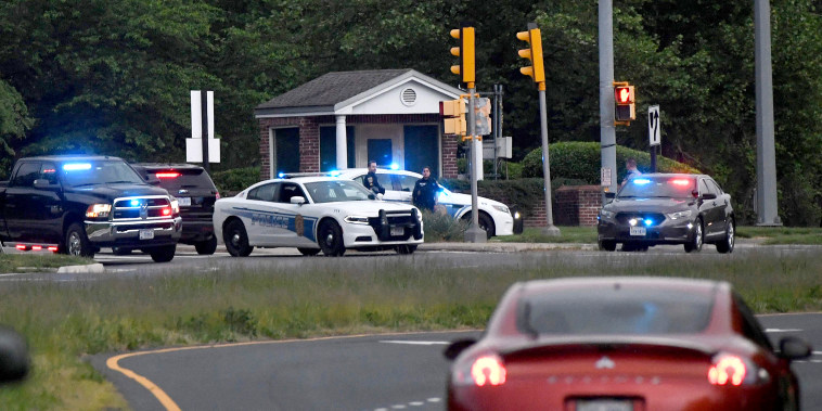 Image: Police cars are seen outside the CIA headquarters's gate after an attempted intrusion earlier in the day in Langley, Va., on May 3, 2021.