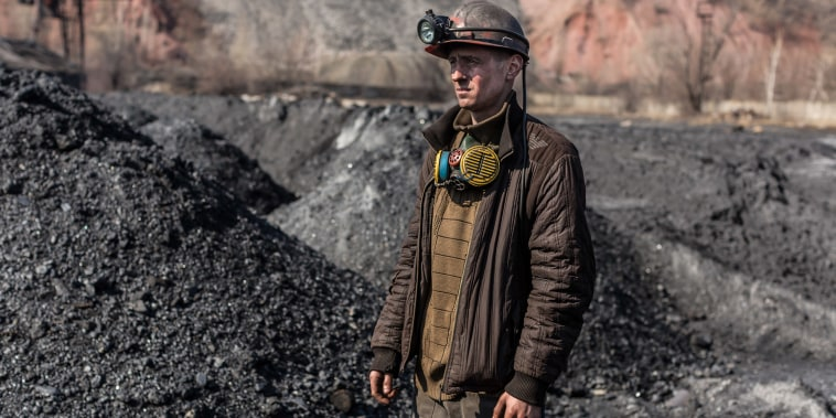 Image: Dmytro Bondar, 26, a miner of the Tsentralna coal mine, poses for a portrait after his shift in Toretsk, Donetsk region, Ukraine
