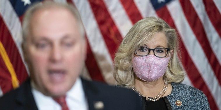 Rep. Liz Cheney, R-Wyo., listens as Rep. Steve Scalise, R-La., speaks on Capitol Hill on April 20, 2021.