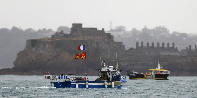 Image: French fishing boats protest in front of the port of Saint Helier off the British island of Jersey to draw attention to what they see as unfair restrictions on their ability to fish in UK waters after Brexit