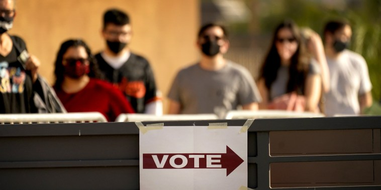 Image: Voters stand in line on Election Day on Nov. 3, 2020, in Mesa, Ariz.