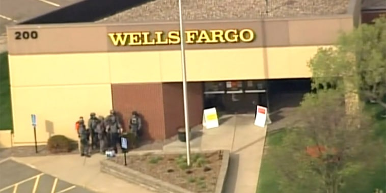 Image: Police are on the scene of a hostage situation at a Wells Fargo Bank in St. Cloud, Minnesota.