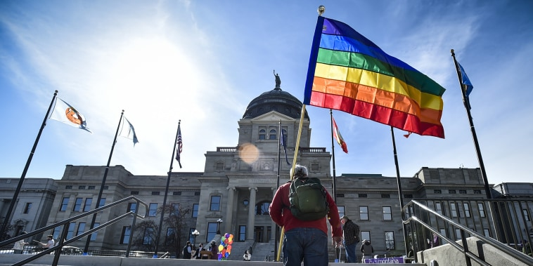 Demonstrators gather on the step of the Montana State Capitol protesting anti-LGBTQ legislation in Helena, Mont., on March 15, 2021.