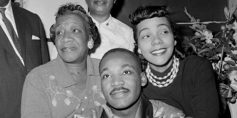 Dr. Martin Luther King, Jr., is embraced by his wife Coretta Scott King during a news conference at Harlem Hospital in New York, Sept 30, 1958. At left is his mother, Alberta Williams King.