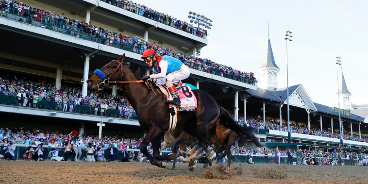 Medina Spirit, ridden by jockey John Velazquez, crosses the finish line to win the 147th running of the Kentucky Derby on May 1, 2021, in Louisville.