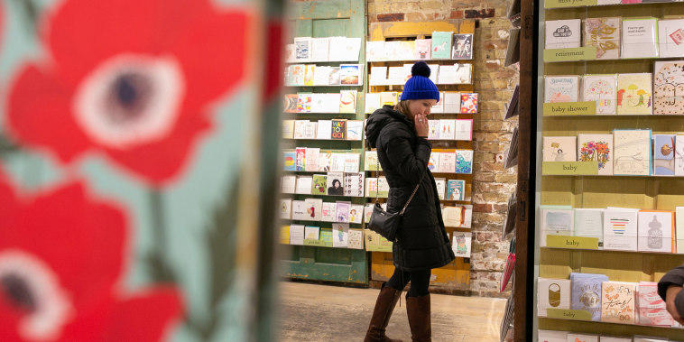 A customer shops for holiday cards at Paper Source in Chicago in 2018.