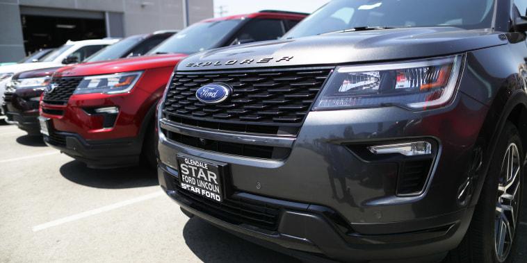 Image: Ford Explorer SUVs are parked for sale at a dealership on June 12, 2019 in Glendale, Calif.
