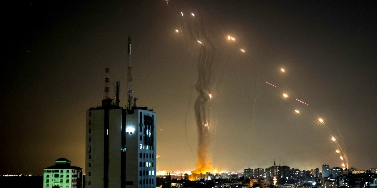 Image: A rocket launched from Gaza city controlled by the Palestinian Hamas movement, is intercepted by Israel's Iron Dome aerial defense system, on May 11, 2021.