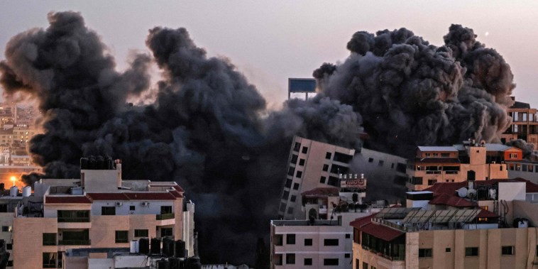 Smoke billows from an Israeli air strike on the Hanadi compound in Gaza City, controlled by the Palestinian Hamas movement, on May 11.