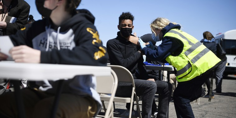 East Hartford High School students receive a vaccination at Pratt & Whitney Runway in East Hartford, Conn., on April 26.