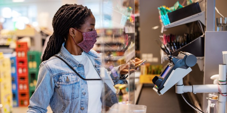 Customer making payment with nfc technology at supermarket