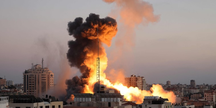 Black smoke billows after an Israeli airstrike on Gaza City targeted the Ansar compund, linked to the Hamas movement, in the Gaza Strip on May 14, 2021.