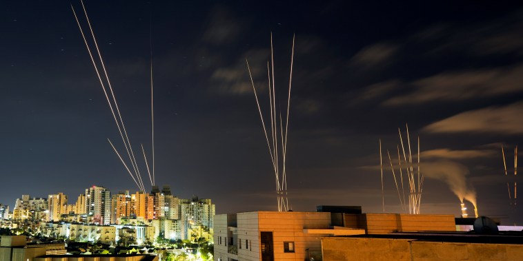 Image: Streaks of light are seen as rockets are launched from the Gaza Strip towards central Israel as seen from Ashkelon, Israel