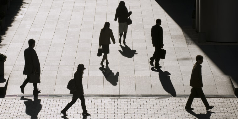 Silhouettes of office employees going to work.