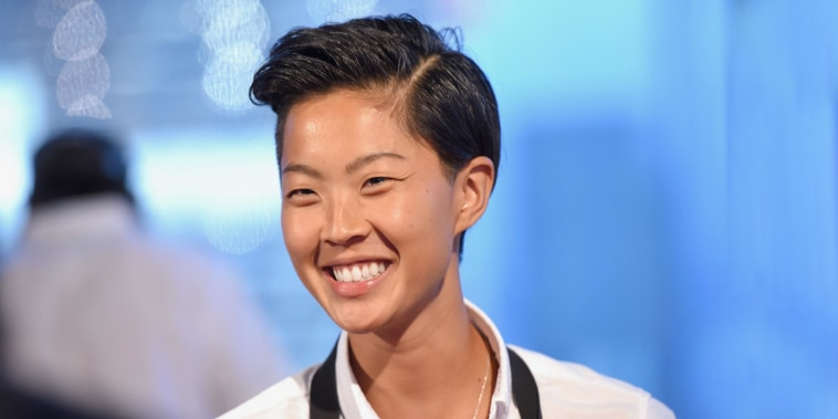 Image of Kristen Kish smiling in the kitchen
