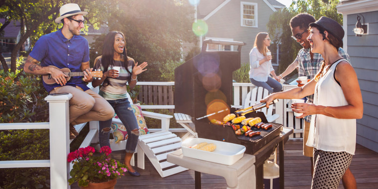 Friends enjoying barbecue on patio
