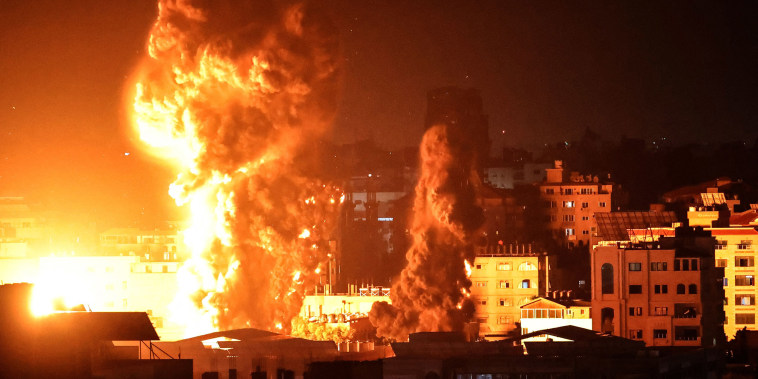 Image: Fire and smoke rise above buildings in Gaza City as Israeli warplanes target the Palestinian enclave