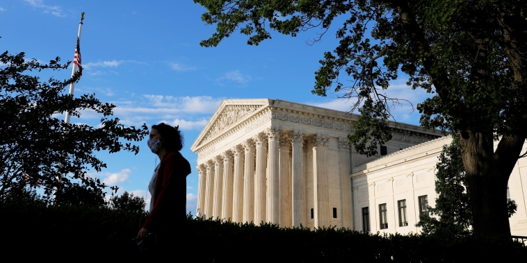 A person walks past the United States Supreme Court Building on May 13, 2021.
