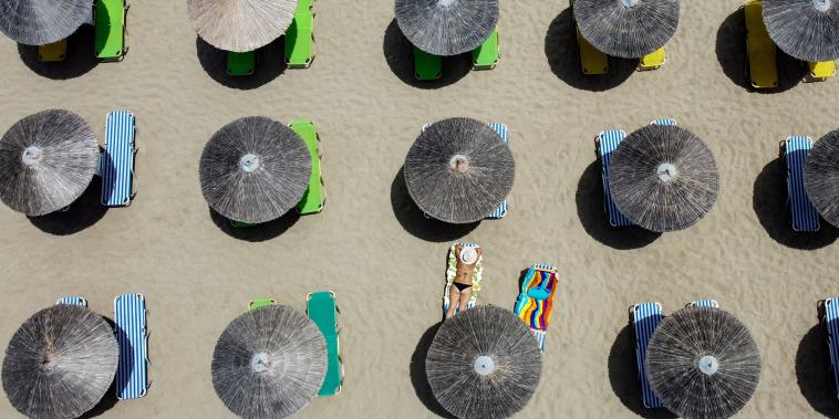 Image: A woman sunbathes at Falaserna beach on the western coast of Crete, Greece