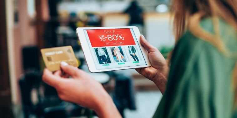 Woman using her iPad to shop online for sales