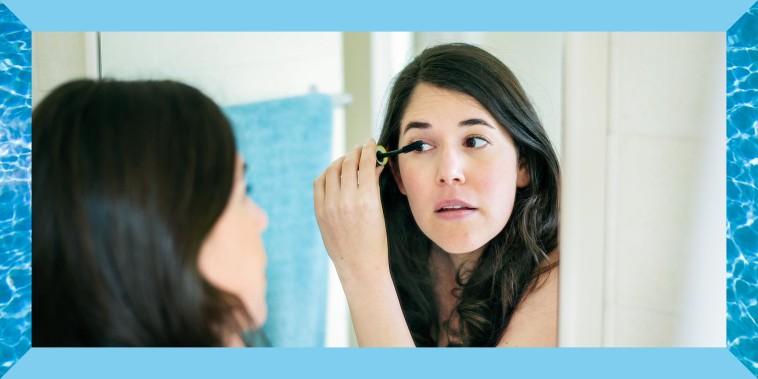 Illustration of a woman putting on mascara in a bathroom mirror