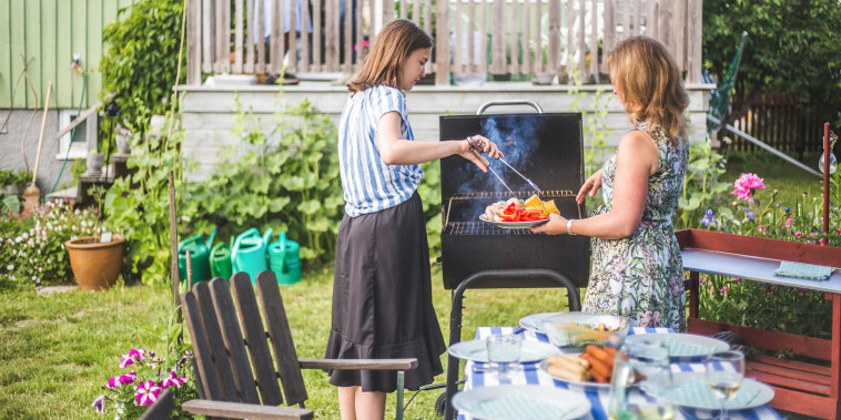 Mother and daughter preparing food on barbecue in backyard party. See the best Memorial Day sales on grills. Shop grills on sale including Weber and Cuisinart grills from Home Depot, Lowes, Macy's and more.