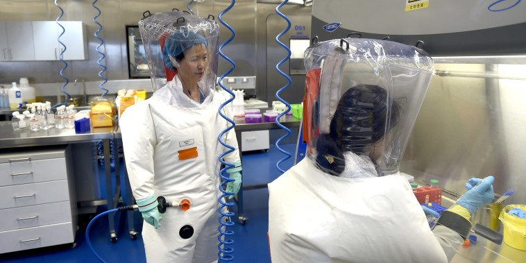 Image: Virologist Shi Zheng-li, left, works with her colleague in the P4 lab of Wuhan Institute of Virology in Wuhan in central China's Hubei province.