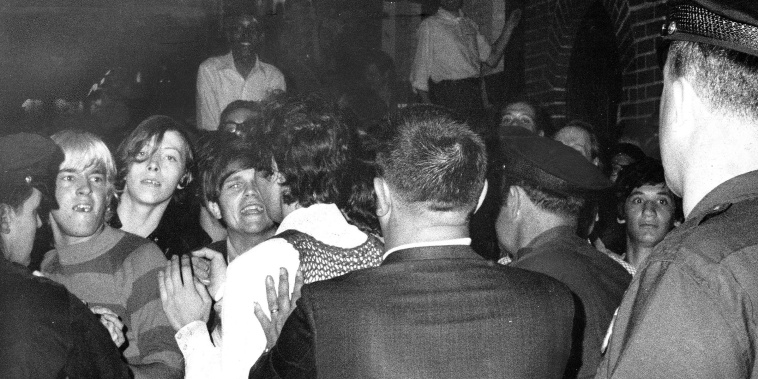 Image: Stonewall Inn nightclub raid. Crowd attempts to impede polic