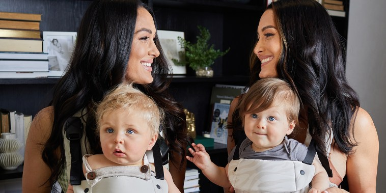 Brie and Nikki Bella spoke with TODAY Parents as part of promoting their new collection of baby gear in collaboration with Colugo.