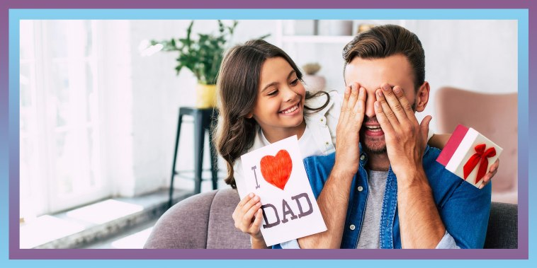 Father closing his eyes while his daughter gives him a card and gift for Fathers Day