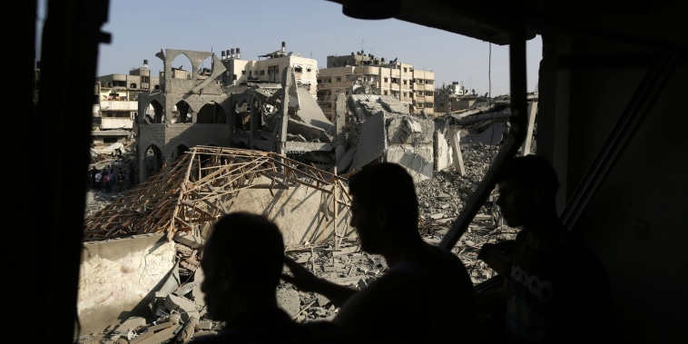 Palestinians look at the remains of a mosque, which witnesses said was hit in an Israeli air strike, in Gaza City on Aug. 2, 2014.