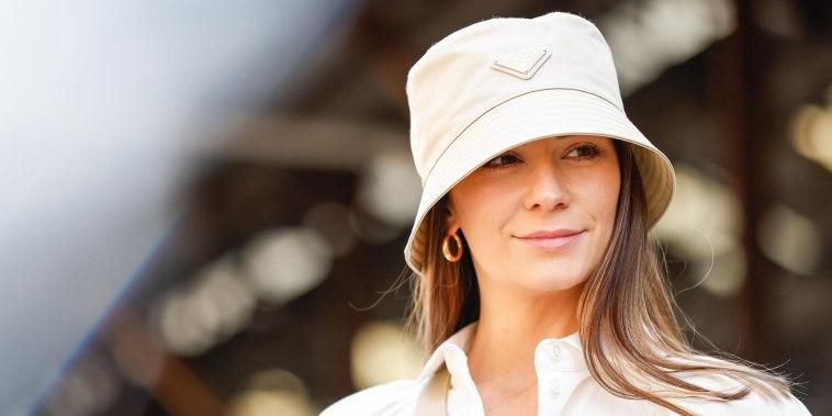 Woman wearing Prada bucket hat
