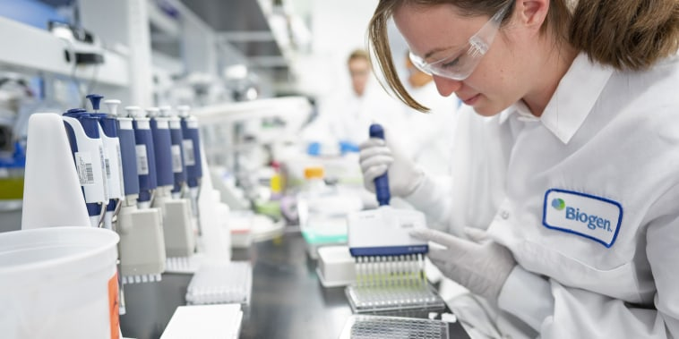 A scientist works on Alzheimer's disease research in a laboratory at Biogen's headquarters in Cambridge, Mass., in 2019.