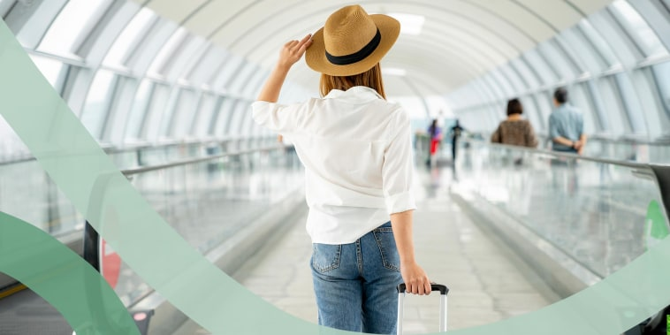 Female traveler with suitcase at airport