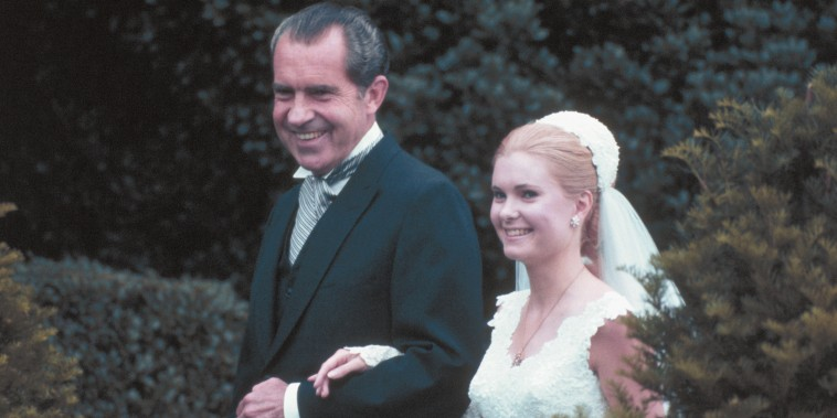 President Richard M. Nixon escorts his daughter Tricia from the White House to the rose garden for her marriage to Edward Finch Cox, June 12th, 1971.