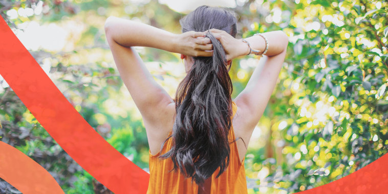 Woman tosing her hair outdoors