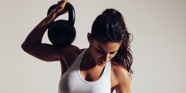 Determined young woman doing gym workout