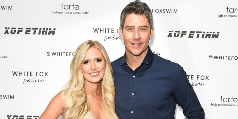 Lauren Burnham and Arie Luyendyk attend White Fox Boutique Swimwear Launch Of 100% Salty at Catch July 26, 2018 in West Hollywood, California.