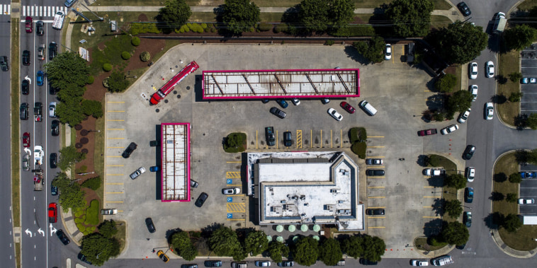 Vehicles wait in lines in Raleigh, N.C., as a tanker truck finishes delivering a 9000 gallon load of fuel on May 13, 2021.