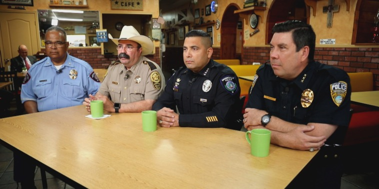 McAllen Police Chief Victor Rodriguez, left, Hidalgo County Sherriff Eddie Guerra, second from left, Brownsville Police Chief Felix Sauceda and Pharr Police Chief Andy Harvey, right, meet for breakfast at the Junction Caf? on May 26, 2021, to talk about h
