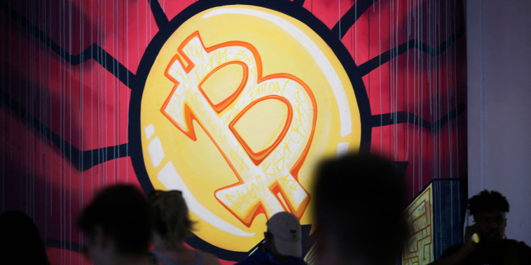 Image: A banner with the logo of bitcoin is seen during the crypto-currency conference Bitcoin 2021 Convention at the Mana Convention Center in Miami,