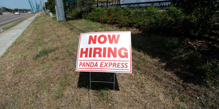 """A Panda Express restaurant displays a \""""Now Hiring\"""" sign in Tampa, Fla., on June 1, 2021."""