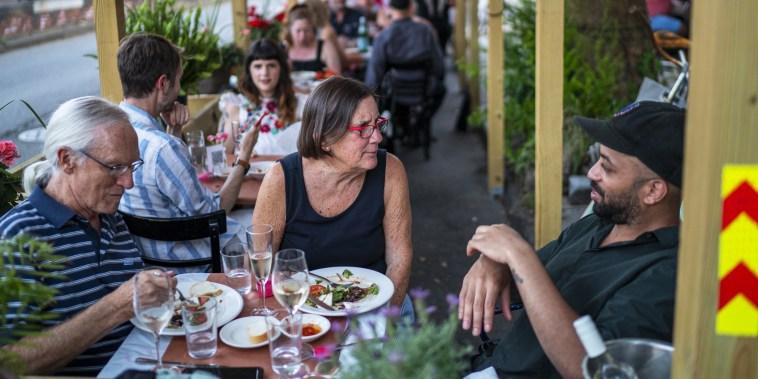 People dine at Petite Crevette in Brooklyn, N.Y., on June 5, 2021.
