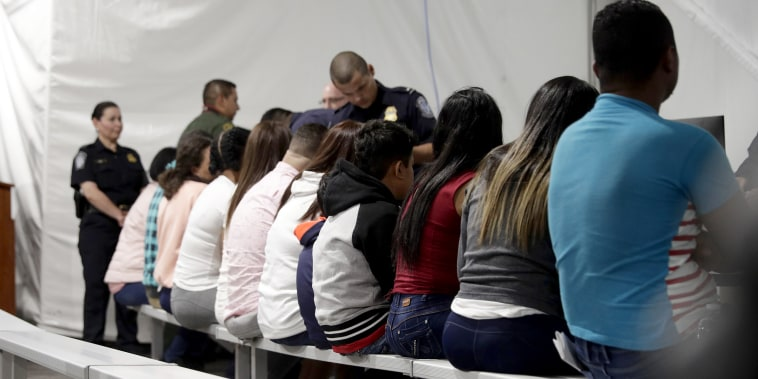 Migrants who are applying for asylum in the United States go through a processing area at a new tent courtroom at the Migration Protection Protocols Immigration Hearing Facility on Sept. 17, 2019, in Laredo, Texas.