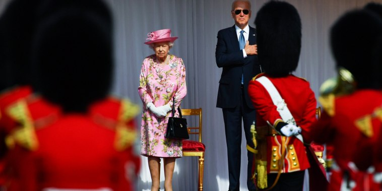 Britain's Queen Elizabeth stands and President Joe Biden stand in front of members of the Royal Guard, at Windsor Castle in Windsor, Britain, on June 13, 2021.