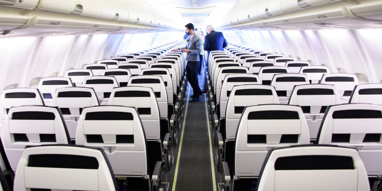 A flight attendant prepares for boarding before an Avelo Airlines from Hollywood Burbank Airport in Burbank, Calif., on April 28, 2021.