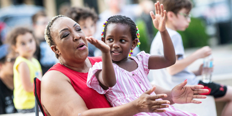 Doris Watkins, left, claps with her granddaughter, Zawadi Odhiambo, 4, during a Juneteenth celebration in Florence, Alabama.