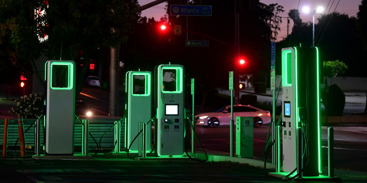 Image: An Electric Vehicle charging station lights up green in the parking lot of a Ralph's supermarket in Monterey Park, Calif., on May 18, 2021.