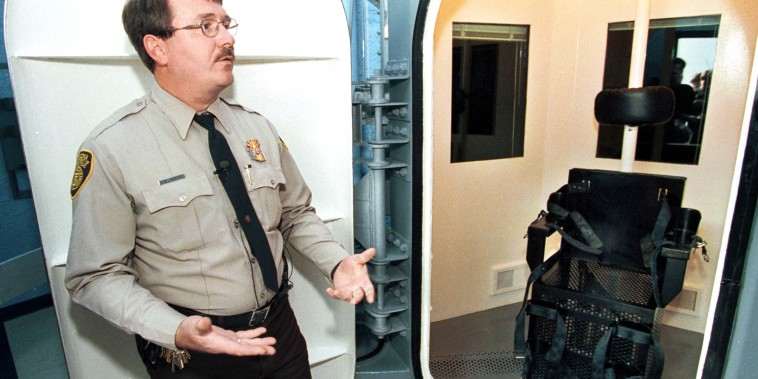 Image: Correctional Officer Jim Robideau shows the gas chamber at the Florence Prison Complex in Florence, Ariz.